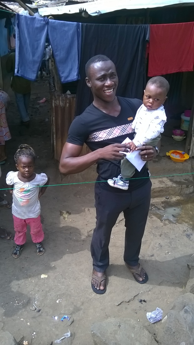 Ibrahim and his baby son receiving donated money during their 21 days in quarantine
